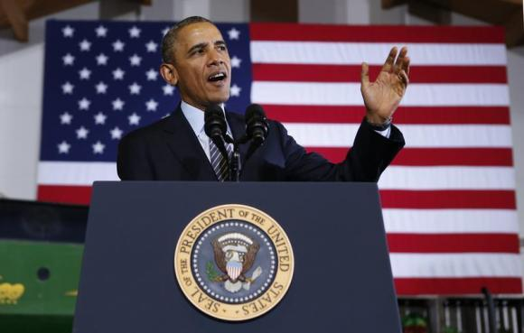 U.S. President Barack Obama speaks during a visit to Michigan State University in Lansing, Michigan February 7, 2014. REUTERS/Kevin Lamarque