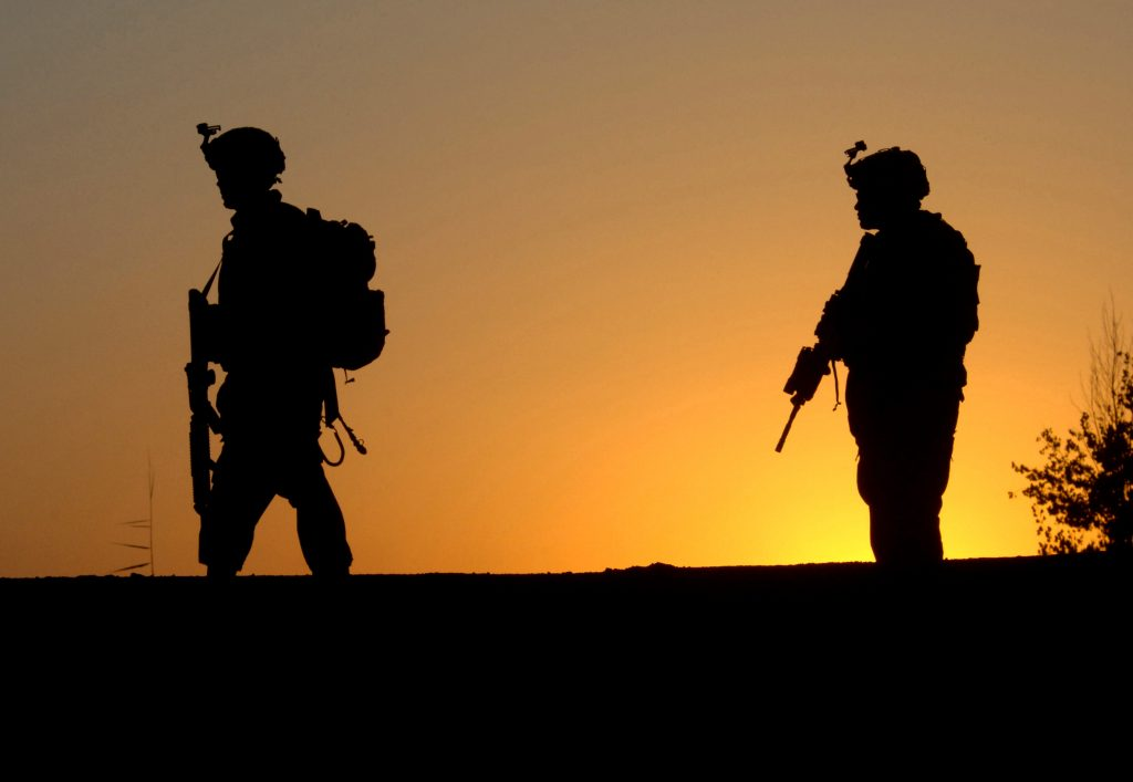 U.S. Army Soldiers assigned 1st Battalion, 66th Armored Regiment patrol a road at sunset during a cordon and search operation in Sheik Hamid, Iraq, Sept. 28, 2006, to gain information on terrorists cells operating in the area. (U.S. Navy photo by Mass Communication Specialist 2nd Class Eli J. Medellin) (Released)